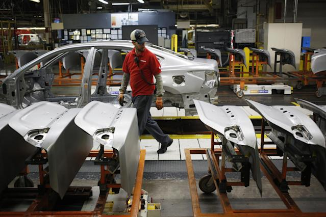 A worker inspects parts for vehicle frames on the assembly line at the Nissan Motor Co. manufacturing facility in Smyrna, Tennessee, U.S., on Tuesday, Oct. 31, 2017. Nissan Motor Co. is scheduled to release earnings figures on November 7. Photographer: Luke Sharrett/Bloomberg