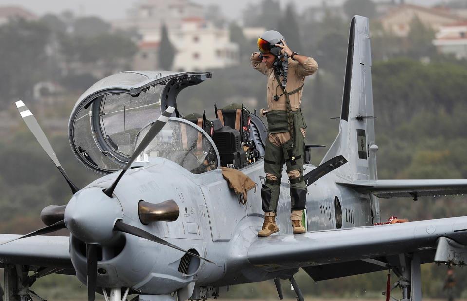 FILE - In this October 31, 2017 file photo, a Lebanese pilot disembarks from a one of six Super Tucano A29 warplanes that handed by the United State to the Lebanese military as part of military aid program, after he finished an air performance, at Hamat military air base, in north Lebanon. The currency collapse has wiped out the salaries of the U.S.-backed Lebanese military, placed unprecedented pressure on the army's operational capabilities with some of the highest attrition rates over the past two years, and raised concerns about its ability to continue playing a stabilizing role while sectarian tensions and crime are on the rise.(AP Photo/Hussein Malla, File)