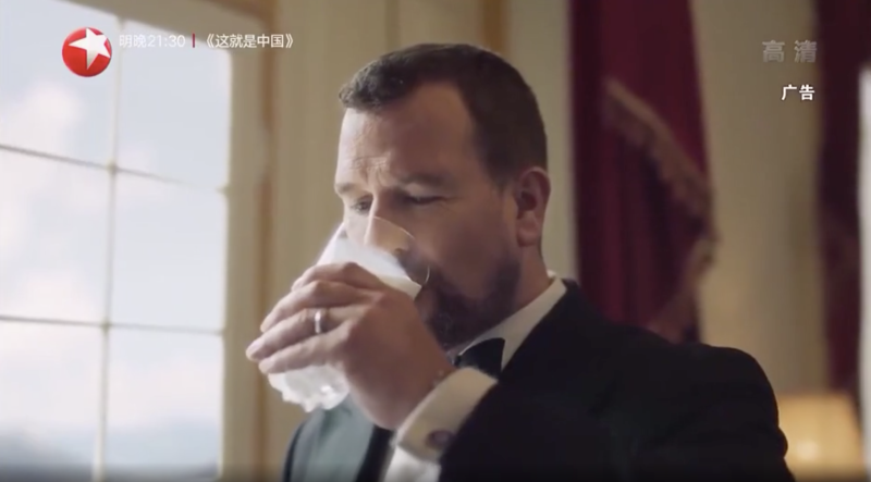 Peter Phillips enjoys a glass of milk.