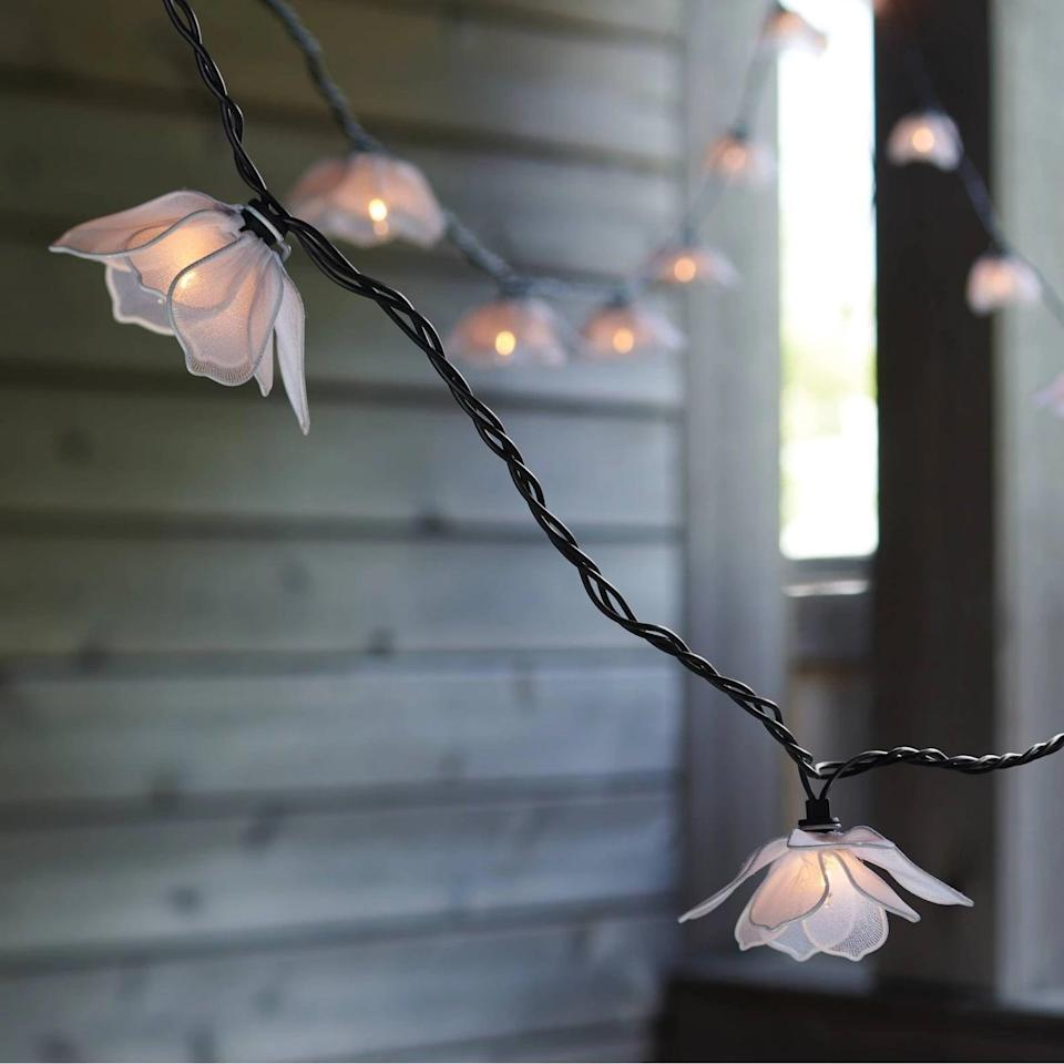 <p>Create a whimsical ambiance with these stunning <span>Threshold 10ct Incandescent Flower Outdoor String Lights White</span> ($15, originally $17).</p>