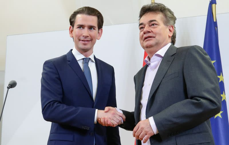 Leader of Austria's Green Party Werner Kogler and head of People's Party (OeVP) Sebastian Kurz shake hands after delivering a statement, in Vienna