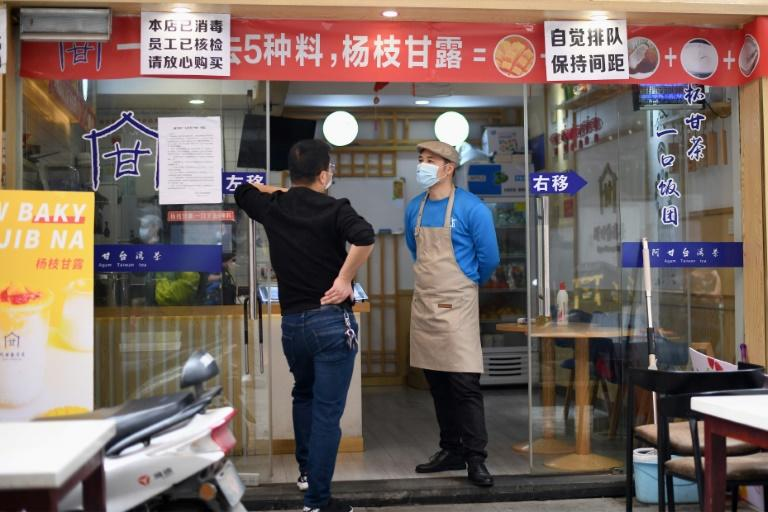 Restaurants in Huanggang have re-opened but diners aren't allowed to eat inside, and are served at outdoor tables instead (AFP Photo/Noel Celis)
