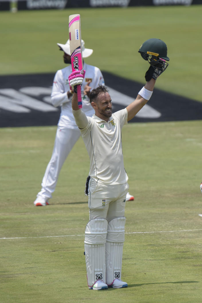 South Africa's Faf du Plessis celebrates as he got his 100 on day three of the first cricket test match between South Africa and Sri Lanka at Super Sport Park Stadium in Pretoria, South Africa, Monday, Dec. 28, 2020. (AP Photo/Catherine Kotze)