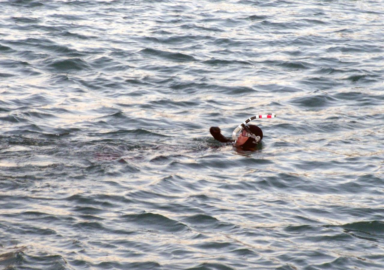 french amputee completes epic swim