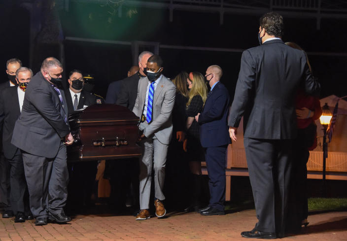 """Former Maryland Senate President Thomas V. """"Mike"""" Miller, who died following complications from cancer last week, is transported into the Maryland State House for a final viewing, Thursday, Jan. 21, 2021. (Ulysses Muñoz/The Baltimore Sun via AP)"""