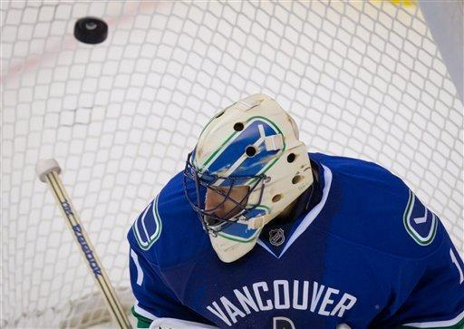 Vancouver Canucks' goalie Roberto Luongo allows a goal by Edmonton Oilers' Ales Hemsky, not pictured, of the Czech Republic, during the third period of an NHL hockey game in Vancouver, British Columbia, on Sunday Jan. 20, 2013. (AP Photo/The Canadian Press, Darryl Dyck)