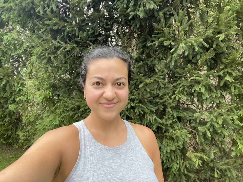 A selfie of the writer in front of a bush