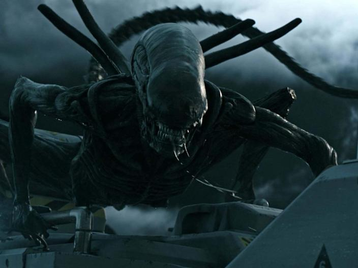 """Ridley Scott has revealed that he's currently working on a sequel to 2017's Alien: Covenant. In an interview with Scott for Variety, tied with Alien's 40th anniversary, it was confirmed that a script for a third prequel – following both Prometheus and Covenant – is currently in development. Scott will once more return to direct. The Alien franchise has come under the ownership of Disney as part of the Fox merger, with the company having already stated that it has plans for more Alien films down the line. Scott also shared an anecdote with The Hollywood Reporter about how the iconic chestburster scene almost went very wrong. He explained that the one-take event almost went awry as cameras were rolling, which would have spoiled the organic reactions he wanted for the cast.""""I had four or five cameras running that morning on that set, and there's power lines, air lines, that will blow blood everywhere,"""" he said.""""I knew once that happens, the white set will be decimated and will take probably two weeks to clean up. So there was no second take. So I positioned everything the way I felt is going to happen, where it was going to come out. And poor John Hurt was lying strapped down on the table under an artificial chest. And we shot and I honestly had to cross my fingers.""""Scott yelled, """"Action!"""", but quickly realised something was terribly wrong.""""The T-shirt didn't open,"""" he said. """"All there is, is this bump in the T-shirt that flashes out and then it goes away. So I scream, 'Cut! Cut! Cut! Cut! Cut!' And all the actors start laughing, but they're kind of nervous because they haven't seen it.""""I go back and say, 'Clear the set!' They all go off the set. I crawl in on top of John Hurt — poor bugger lying there — and I'm razor-blading the T-shirt so it will pop when the alien hits the back of the T-shirt. We went again. And it was perfect.""""In his tribute to Alien, The Independent's critic Ed Cumming wrote how the original is """"still the most gripping sci-fi horror ever made""""."""