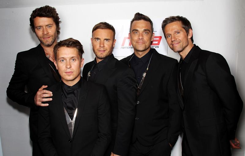 LONDON, ENGLAND - MAY 11: L-R Howard Donald, Mark Owen, Gary Barlow, Robbie Williams and Jason Orange of Take That pose backstage prior to performing at the National Movie Awards 2011 at Wembley arena on May 11, 2011 in London, England. (Photo by Dave J Hogan/Getty Images)