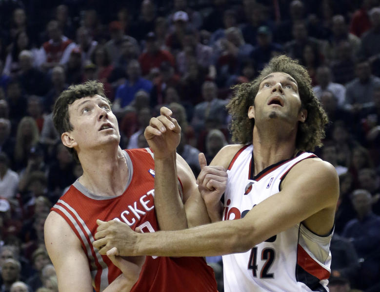 Houston Rockets center Omer Asik, left, and Portland Trail Blazers center Robin Lopez jockey for position on a free throw during the first half of Game 3 of an NBA basketball first-round playoff series in Portland, Ore., Friday, April 25, 2014. (AP Photo/Don Ryan)