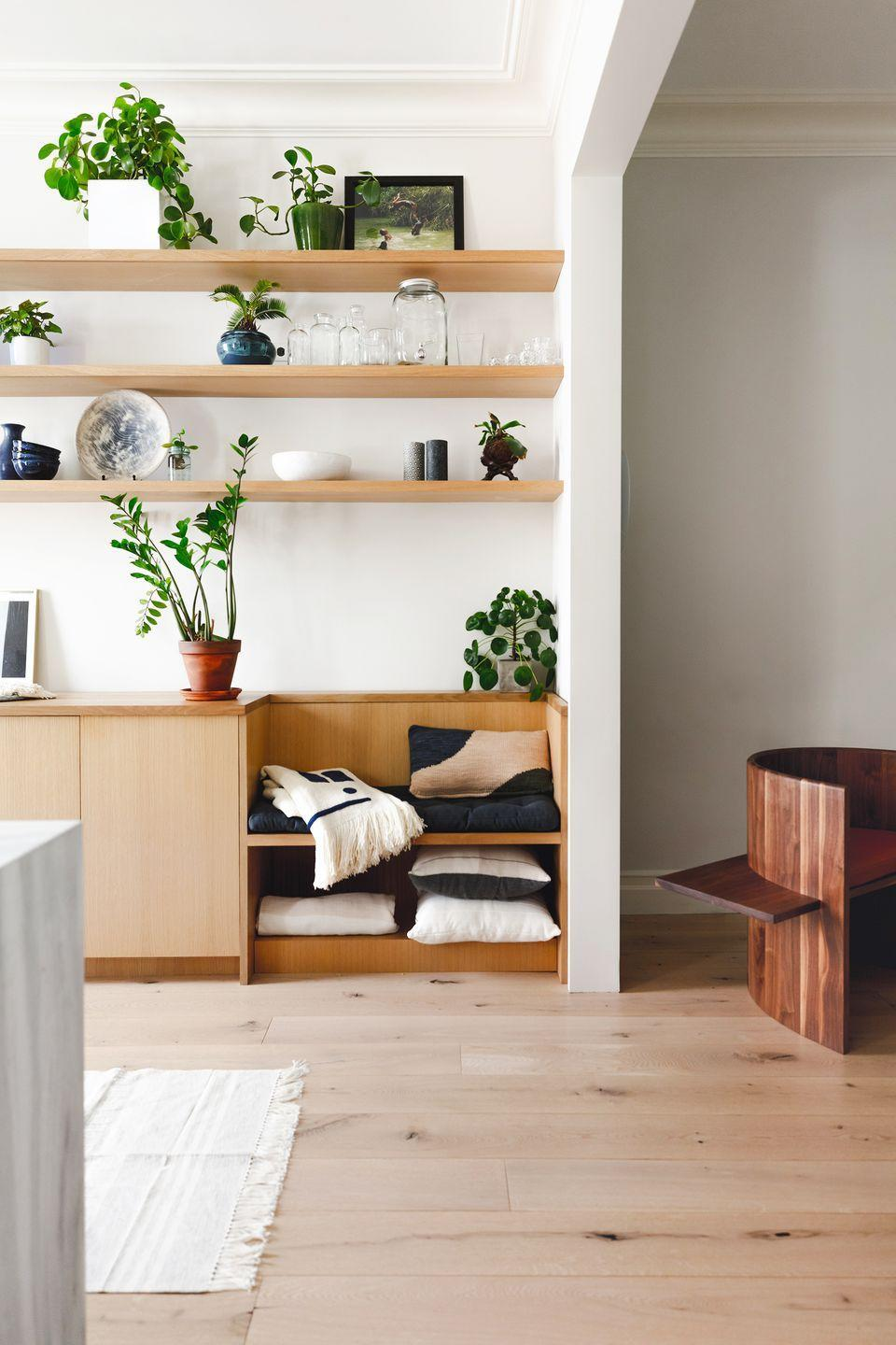 """<p>Floating shelves can be bold and over-the-top when decorated a certain way, but the emphasis on material and shape also makes them also a minimalists dream. In this space designed by <a href=""""https://www.shapelessstudio.com/"""" rel=""""nofollow noopener"""" target=""""_blank"""" data-ylk=""""slk:Shapeless Studio"""" class=""""link rapid-noclick-resp"""">Shapeless Studio</a>, the wall-to-wall floating shelves for make for a neutral, linear, and clean display—almost gallery-esque, yet still approachable and grounded. </p>"""