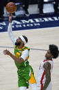 Utah Jazz guard Mike Conley (10) lays the ball up as Houston Rockets guard Kevin Porter Jr. defends during the first half during an NBA basketball game Friday, March 12, 2021, in Salt Lake City. (AP Photo/Rick Bowmer)
