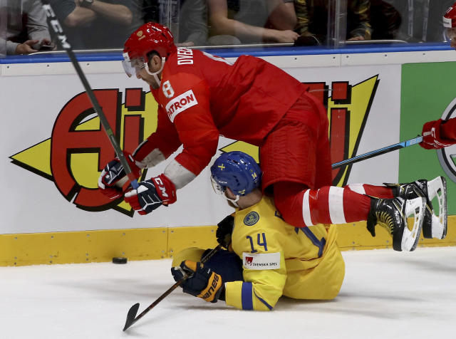 Russia's Alexander Ovechkin checks Sweden's Mattias Ekholm, from left, during the Ice Hockey World Championships group B match between Sweden and Russia at the Ondrej Nepela Arena in Bratislava, Slovakia, Tuesday, May 21, 2019. (AP Photo/Ronald Zak)