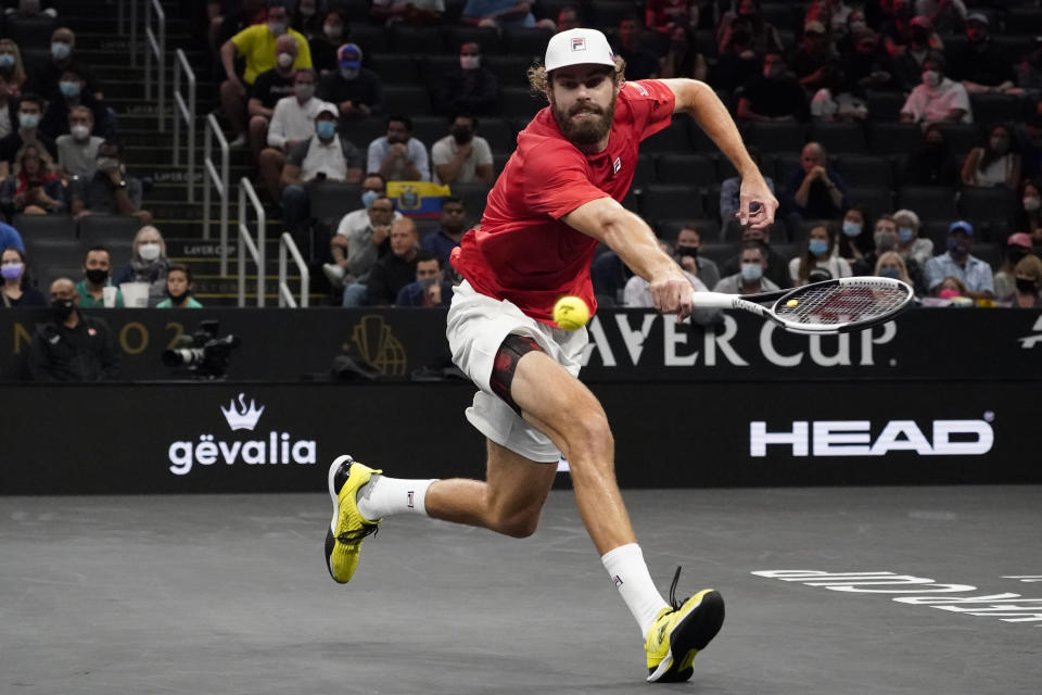 Team World's Reilly Opelka, of the USA, returns the ball to Team Europe's Casper Ruud, of Norway, at Laver Cup tennis, Friday, Sept. 24, 2021, in Boston. (AP Photo/Elise Amendola)