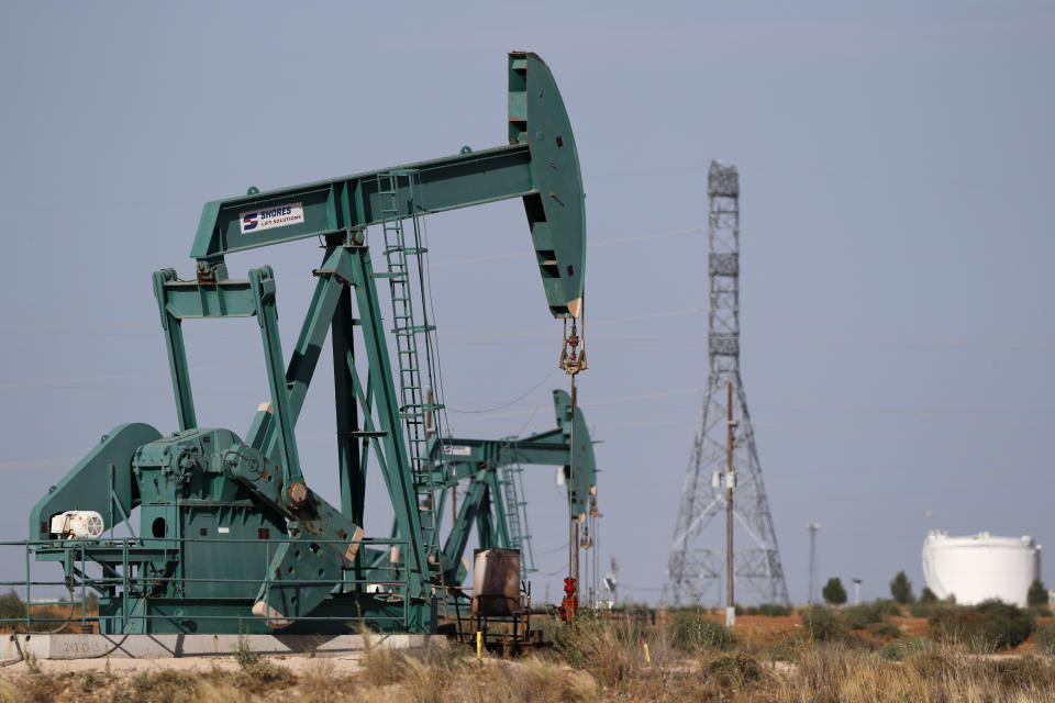 Pump jacks are shown in an oil field, Wednesday, July 29, 2020, in Midland, Texas. (AP Photo/Tony Gutierrez)
