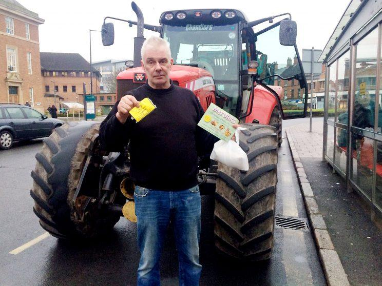 A farmer who dumped five tonnes of manure outside a court building during a row with a law firm has been evicted from his home.