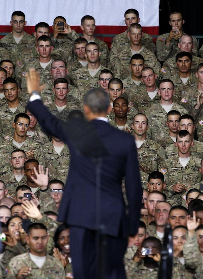 President Barack Obama waves to service-members after speaking to them and their families at the 1st Aviation Support Battalion Hangar at Fort Bliss, Friday, Aug. 31, 2012, in El Paso, Texas. (AP Photo/Tony Gutierrez)