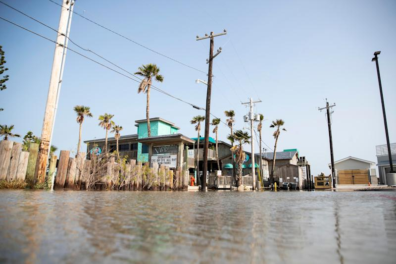 Flood waters fill the parking lot near Virginia's On the Bay in Port Aransas, TX on Sunday, Sept. 20, 2020.