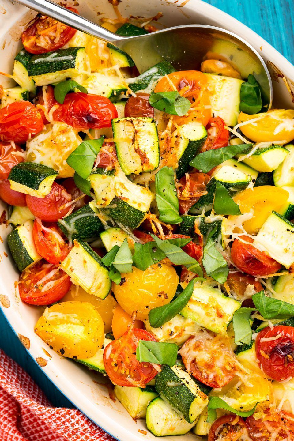 "<p>This easy side is the most delicious way to use up your summer vegetables.</p><p>Get the recipe from <a href=""https://www.delish.com/cooking/recipe-ideas/recipes/a47357/zucchini-tomato-bake-recipe/"" rel=""nofollow noopener"" target=""_blank"" data-ylk=""slk:Delish"" class=""link rapid-noclick-resp"">Delish</a>.</p>"