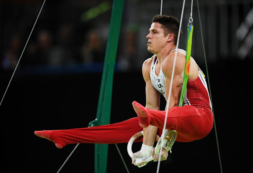 American Christopher Brooks competes on the horizontal bar during the men's individual all-around final. (Getty Images)