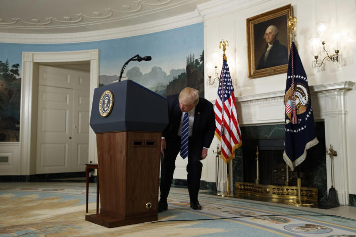 President Trump in search of water during a statement on his trip to Asia. (Photo: Evan Vucci/AP)