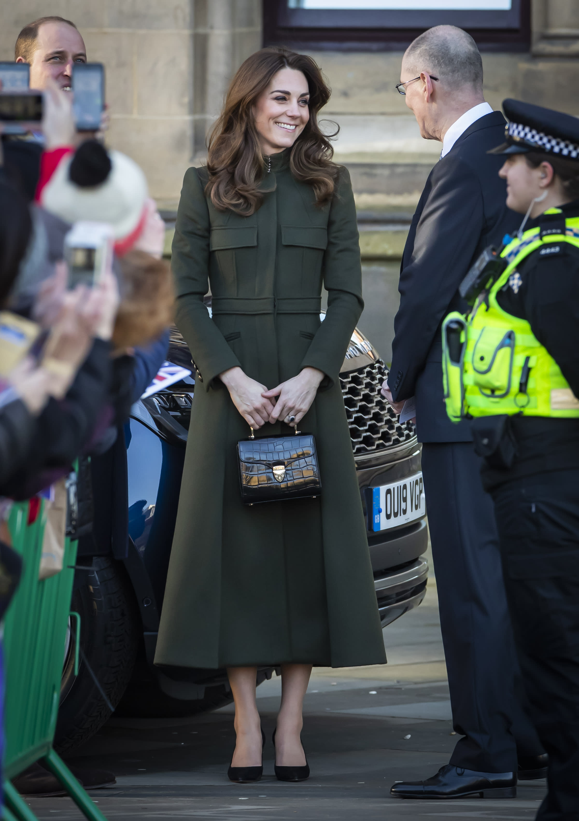 The Duchess of Cambridge debuted her latest Aspinal of London bag at City Hall in Bradford to join a group of young people from across the community to hear about life in the city. [Photo: Getty]