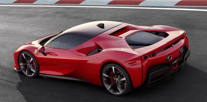 A red Ferrari SF90 Stradale, a low-slung, mid-engined, two-seat hybrid sports car