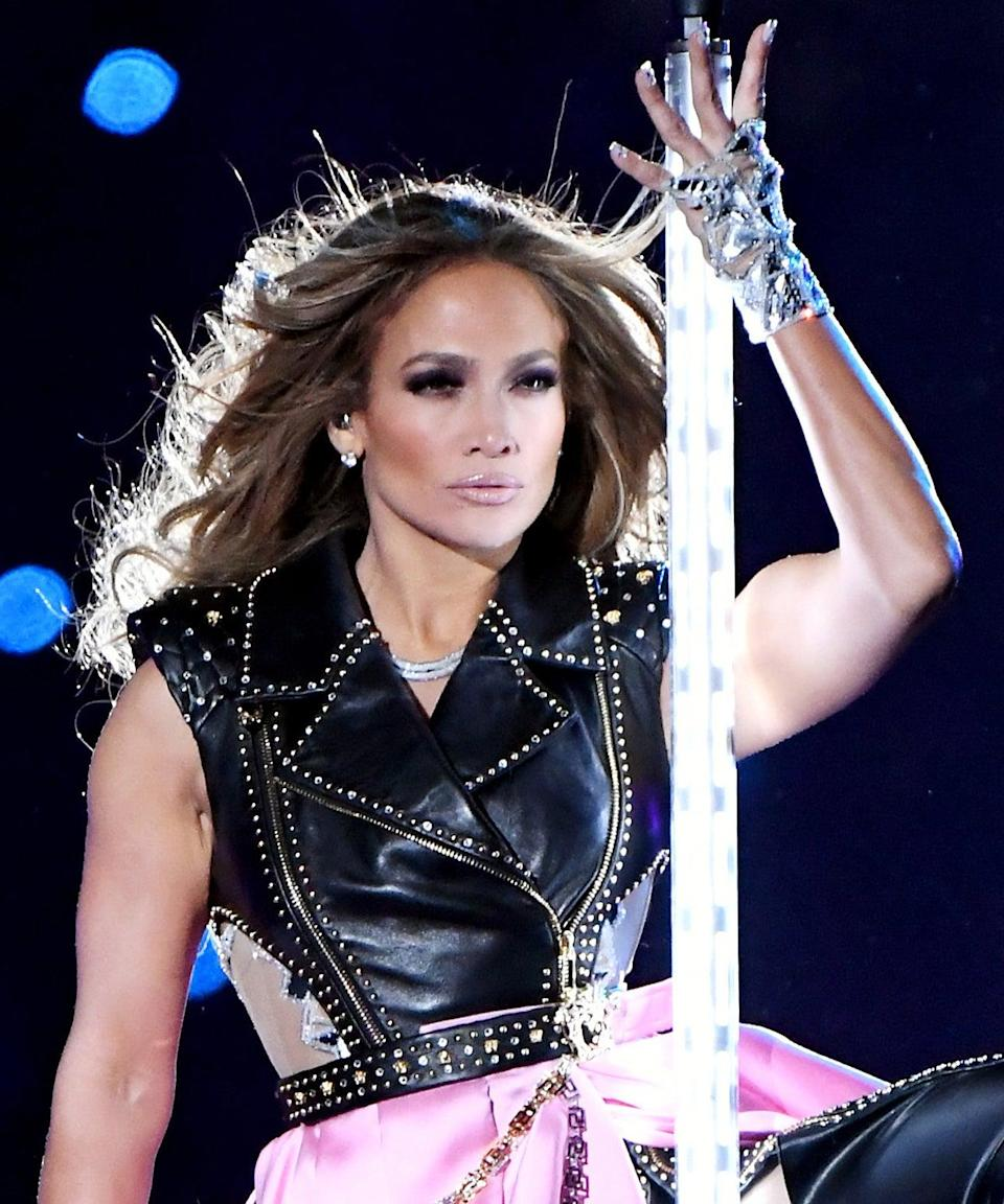"""<h3>2020</h3><br>J.Lo's historic Super Bowl halftime show is one for the books. Not only did her <em>Hustlers</em>-inspired pole-dancing routine leave us cheering, but so did her <a href=""""https://www.refinery29.com/en-us/2020/02/9345421/jennifer-lopez-hair-makeup-super-bowl-2020"""" rel=""""nofollow noopener"""" target=""""_blank"""" data-ylk=""""slk:bouncy, waist-length blowout and eye-catching makeup"""" class=""""link rapid-noclick-resp"""">bouncy, waist-length blowout and eye-catching makeup</a>.<span class=""""copyright"""">Photo: Jeff Kravitz/FilmMagic.</span>"""