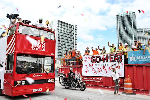 MIAMI, FL - JUNE 24: Forward Lebron James #6 of the Miami Heat rides a bus during the Championship victory parade on the streets on June 24, 2013 in Miami, Florida. The Miami Heat defeated the San Antonio Spurs in the NBA Finals. (Photo by Marc Serota/Getty Images)