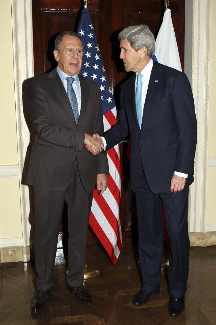 Russian Foreign Minister Sergey Lavrov, left, and US Secretary of State John Kerry shake hands prior to a meeting at Winfield House in London, Friday March 14, 2014. U.S. Secretary of State John Kerry flew to London on Friday to meet with Russian Foreign Minister Sergey Lavrov in a last-minute bid to stave off a new chapter in the East-West crisis over Ukraine. (AP Photo/Sean Dempsey, Pool)