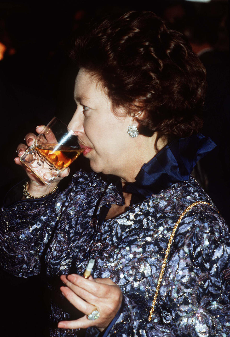 LONDON, ENGLAND - JANUARY 01:  Princess Margaret drinks and smokes at a party circa 1980 in London, England (Photo by Anwar Hussein/Getty Images)