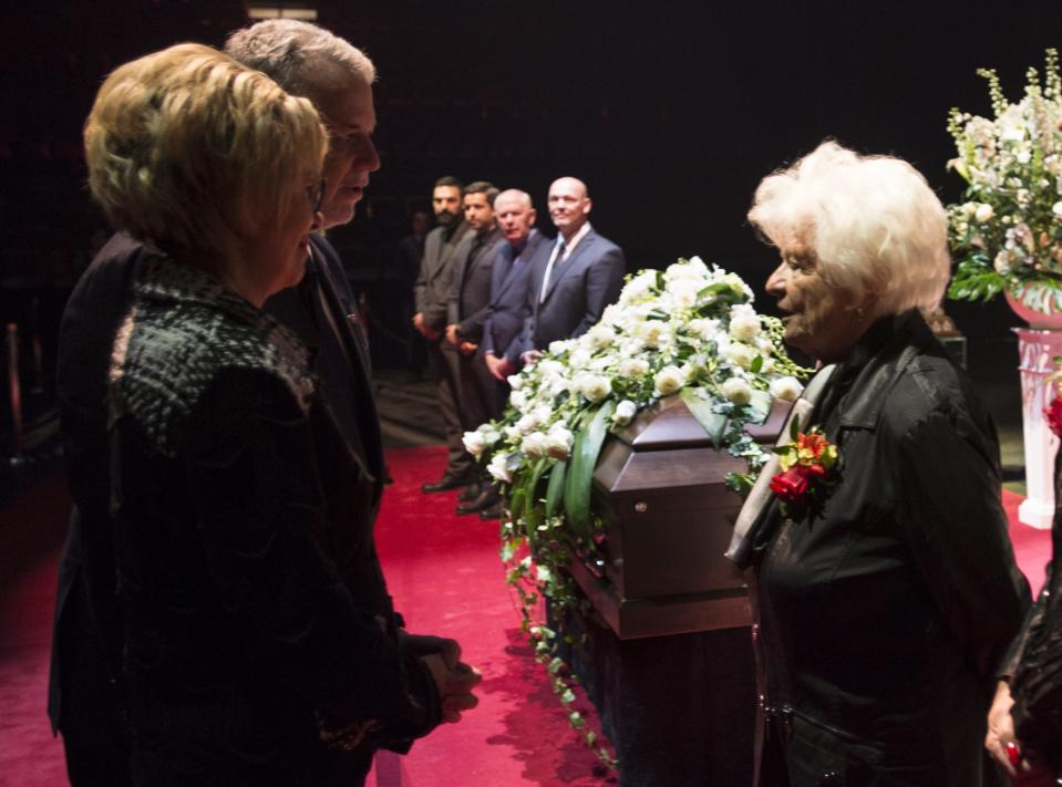 Quebec Premier Philippe Couillard and his wife Suzanne Pilote, left, offer their condolences to Elise Beliveau, wife of Montreal Canadiens legend Jean Beliveau during the public viewing for the Montreal Canadiens legend Jean Beliveau Sunday, Dec. 7, 2014, in Montreal. (AP Photo/The Canadian Press, Paul Chiasson)