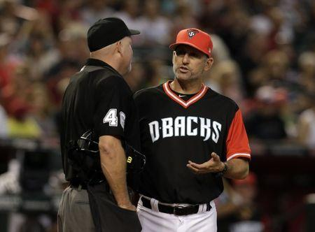 FILE PHOTO: Aug 27, 2017; Phoenix, AZ, USA; Arizona Diamondbacks manager Torey Lovullo (17) talks with MLB umpire Ron Kulpa (46) after Kulpa threw David Peralta (6) out of the game for arguing balls and strikes against the San Francisco Giants in the fifth inning at Chase Field. Rick Scuteri-USA TODAY Sports
