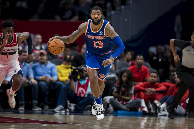 WASHINGTON, DC - OCTOBER 07: Marcus Morris #13 of the New York Knicks dribbles the ball against the Washington Wizards during the first half at Capital One Arena on October 7, 2019 in Washington, DC. NOTE TO USER: User expressly acknowledges and agrees that, by downloading and or using this photograph, User is consenting to the terms and conditions of the Getty Images License Agreement. (Photo by Scott Taetsch/Getty Images)