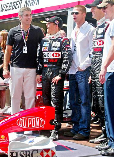 United States actors George Clooney, left, Brad Pitt, third from left, and Matt Damon, right, pose in front of the Jaguar pit with Jaguar Formula One drivers Christian Klien of Austria, second from left, and Mark Webber of Australia during the practice sessions ahead of the Monaco Formula One Grand Prix, Saturday, May 22, 2004. The Monaco Grand Prix takes place Sunday May 23. (AP Photo/Lionel Cironneau)