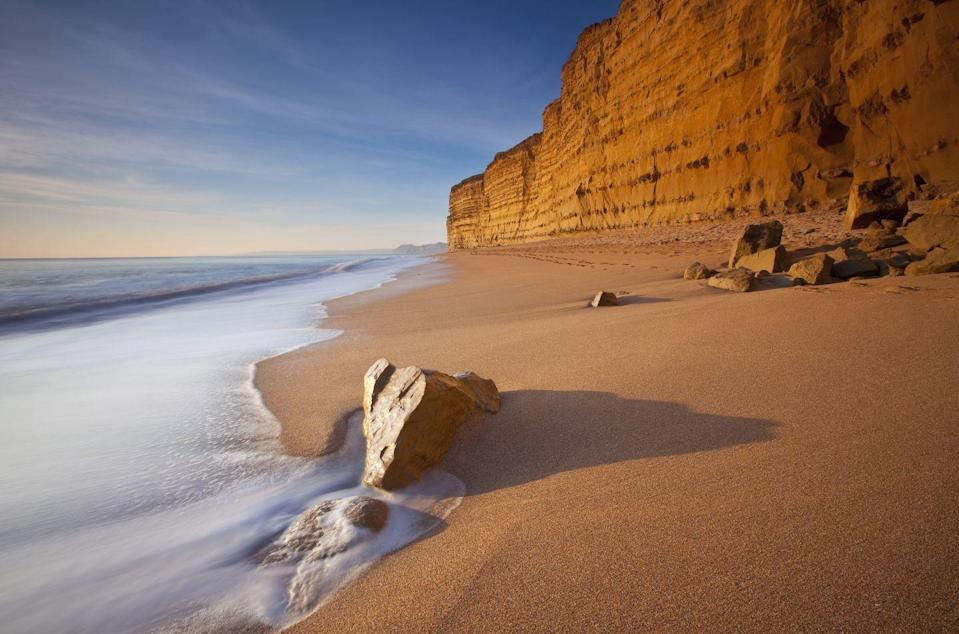 """<p>Beach-lovers will definitely want to plan a visit to Burton Bradstock, an idyllic spot with sandstone cliffs along the Jurassic Coast, that marks the start of the iconic Chesil Beach. As well as stunning views out to sea, traditional tearooms and an excellent seafood restaurant make this Dorset village a winner for us. </p><p>The Hive Beach Café has a gorgeous sun-deck for alfresco dining, and the National Trust-managed Hive Beach is a firm favourite with families, while nearby West Bay will be instantly recognisable to fans of ITV's Broadchurch.</p><p><strong>Where to stay: </strong>For a classy stay a few miles from the beach, try <a href=""""https://go.redirectingat.com?id=127X1599956&url=https%3A%2F%2Fwww.booking.com%2Fhotel%2Fgb%2Fthe-bull-dorset.en-gb.html%3Faid%3D2070936%26label%3Ddorset-villages&sref=https%3A%2F%2Fwww.prima.co.uk%2Ftravel%2Fg35967807%2Fdorset-villages%2F"""" rel=""""nofollow noopener"""" target=""""_blank"""" data-ylk=""""slk:The Bull Hotel"""" class=""""link rapid-noclick-resp"""">The Bull Hotel</a>, a boutique coaching inn with stylish rooms in the charming market town of Bridport. </p><p><a class=""""link rapid-noclick-resp"""" href=""""https://go.redirectingat.com?id=127X1599956&url=https%3A%2F%2Fwww.booking.com%2Fhotel%2Fgb%2Fthe-bull-dorset.en-gb.html%3Faid%3D2070936%26label%3Ddorset-villages&sref=https%3A%2F%2Fwww.prima.co.uk%2Ftravel%2Fg35967807%2Fdorset-villages%2F"""" rel=""""nofollow noopener"""" target=""""_blank"""" data-ylk=""""slk:CHECK AVAILABILITY"""">CHECK AVAILABILITY</a></p>"""