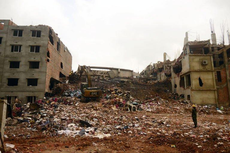 Excavators clear debris at the site of the eight-storey building collapse in Savar, Bangladesh, May 4, 2013