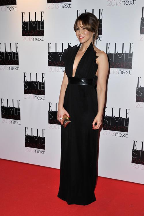 Rachel Stevens looked stunning in a slit-to-the-navel black gown and simple gold clutch.<br><br>©Getty