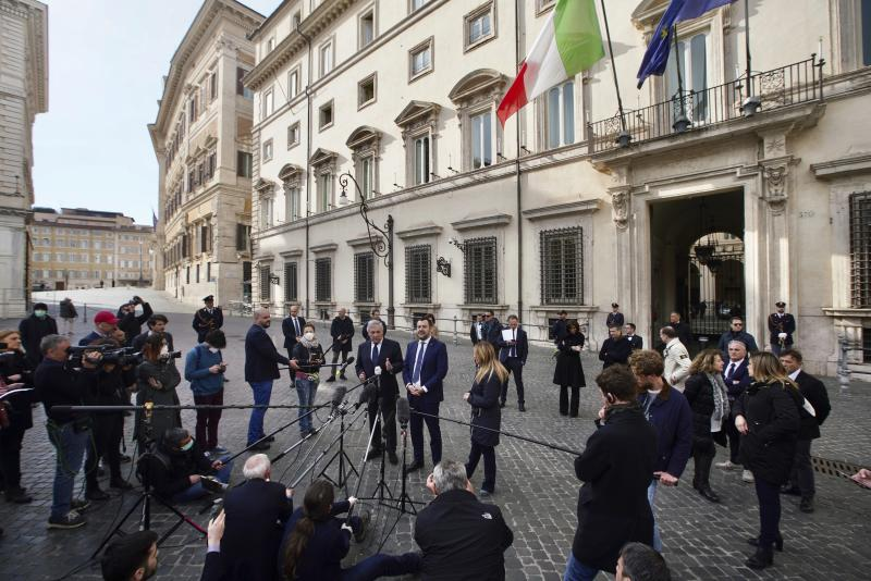 Journalists keep their distance as the League leader Matteo Salvini, center, is flanked by Brothers of Italy Giorgia Meloni, right, and former European Parliament President Antonio Tajani give a statement to journalists after meeting with Italian Premier Giuseppe Conte, outside Chigi palace in Rome, Tuesday, March 10, 2020. Italy entered its first day under a nationwide lockdown after a government decree extended restrictions on movement from the hard-hit north to the rest of the country to prevent the spreading of coronavirus. (AP Photo/Andrew Medichini)