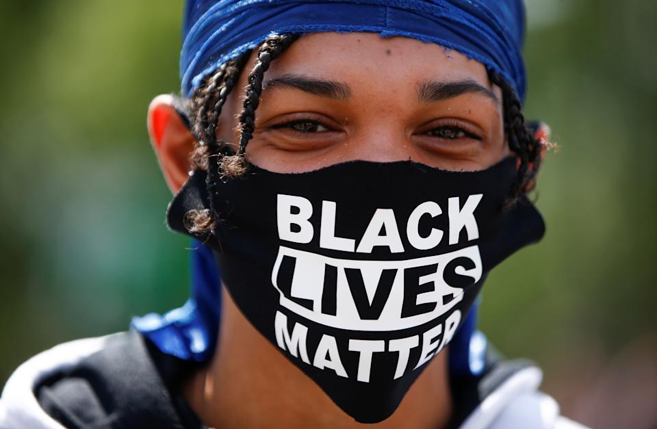 A demonstrator wears a face mask during a Black Lives Matter protest at Marble Arch, in London, Britain, July 12, 2020. REUTERS/Henry Nicholls