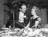 <p>The Academy Award winner was invited to present an award to Walt Disney for <em>Snow White and the Seven Dwarfs</em>. Here, the actress chats with the visionary filmmaker and his unique Oscar, which boasted seven mini statues to represent the seven dwarfs.</p>