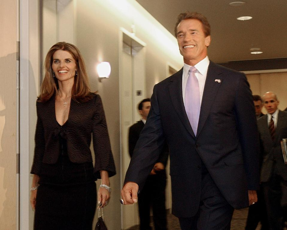 """FILE -- In this file photo taken Nov. 16, 2003, then Gov.-elect Arnold Schwarzenegger and his wife, Maria Shriver, smile as they walk to a meeting of his transition committee, in Sacramento, Calif. In an interview with """"60 minutes"""" that is scheduled to air Sunday, Schwarzenegger says the affair he had with longtime housekeeper Mildred Baena, that led to a son, was """"the stupidest thing"""", he ever did to then-wife Maria Shriver.(AP Photo/Rich Pedroncelli, file)"""