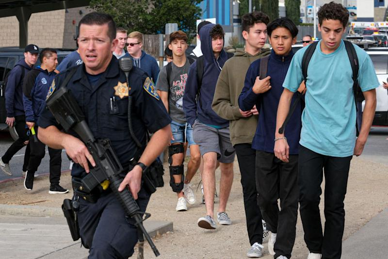 Law enforcement oversees the evacuation of students from Saugus high. Source: Getty Images