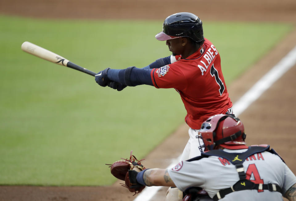 Atlanta Braves' Ozzie Albies swings for a double against the St. Louis Cardinals during the first inning of a baseball game Friday, June 18, 2021, in Atlanta. (AP Photo/Ben Margot)