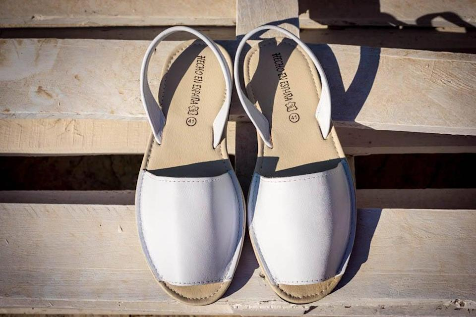 """<h3>Mira Art Shoes Avarcas Sandals</h3> <br>Luckily, you don't have to travel to Menorca to nab a pair of Avarcas — the classic, artisan-made Spanish sandal is available through independent sellers on platforms like Etsy.<br><br><strong>Cleaning Hack:</strong> Keep the hand-sewn leather uppers clean and hydrated by treating them with a white shoe polish, which will brighten any dull or dingy spots. <br><br><strong>Mira Art Shoes</strong> Avarcas Sandals, $, available at <a href=""""https://go.skimresources.com/?id=30283X879131&url=https%3A%2F%2Fwww.etsy.com%2Flisting%2F280119530%2Fhandmade-leather-sandals-for-women"""" rel=""""nofollow noopener"""" target=""""_blank"""" data-ylk=""""slk:Etsy"""" class=""""link rapid-noclick-resp"""">Etsy</a><br><br><strong>KIWI</strong> White Shoe Polish, $, available at <a href=""""https://www.amazon.com/Kiwi-Shoe-Polish-White-8OZ/dp/B00404SHYI/ref=asc_df_B00404SHYI"""" rel=""""nofollow noopener"""" target=""""_blank"""" data-ylk=""""slk:Amazon"""" class=""""link rapid-noclick-resp"""">Amazon</a><br><br><br>"""