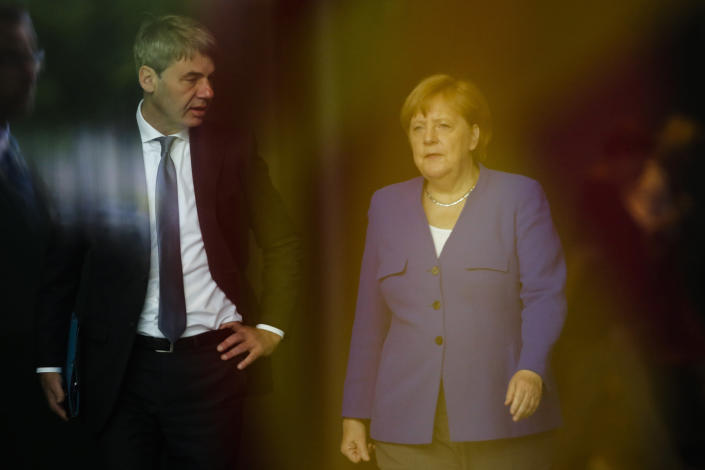 FILE - In this June 13, 2019, file photo, German Chancellor Angela Merkel, right, talks to then foreign policy advisor Jan Hecker, left, as she arrives to welcome the Prime Minister of North Macedonia Zoran Zaev for a meeting at the chancellery in Berlin, Germany. Jan Hecker, Germany's new ambassador to China, a former adviser to Merkel, has died, the German Foreign Ministry said Monday, Sept, 6, 2021. (AP Photo/Markus Schreiber, File)