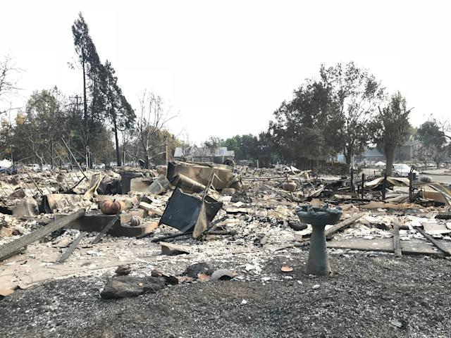 Ashes and debris litter the ground where the Heims' house once stood in Santa Rosa.<br><br>