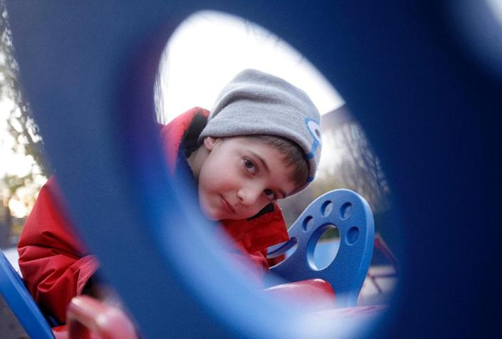 Seven-year-old Aron, who was born with epilepsy, can now join the fun on specially built equipment in some 30 Budapest playgrounds (AFP Photo/Peter Kohalmi)