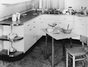 <p>Custom cabinetry was a popular option in the affluent '50s. White enamel and stainless steel reflect a more practical consideration. </p>