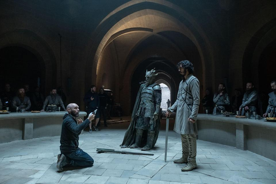 """""""The Green Knight"""" director David Lowery, left, Ralph Ineson and Dev Patel on the set in Ireland."""